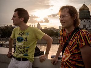 Pavel and Andreij, Coordinator and President of Rainbow Association, a Moscow group for the defense of LGBT rights, at sunset along the Moskva river. Behind them the Cathedral of Christ the Saviour.