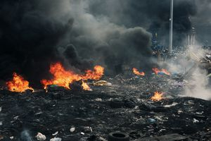 Burning area between police force and protesters (Ukraine, Kiev, February, 2014)