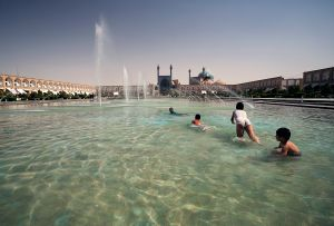 Esfahan, Iran: In the hot July afternoon the children refresh themselves in the lake on Imam's square. © Matjaz Krivic