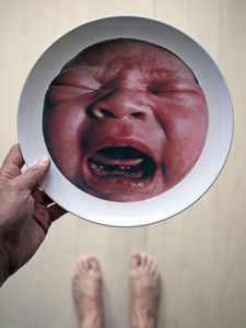 Some men deal with their baby rage by drinking. I made plates. Do all baby pictures have to be carved out of a block of solid saccharin? © Phillip Toledano