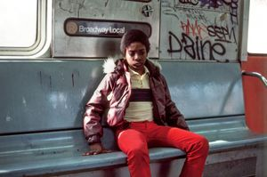 Young Man on the Train, Long Island City, NY, 1985 © Robert Herman
