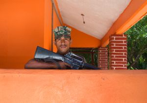 Anonymous soldier guards naval family residences. Ixtapa.