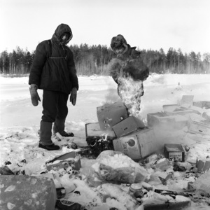 The local tramps are heated by the fire at the village junk yard in minus 35-degrees Celsius. Russia. Tomsk region. Sredniy Vasyugan. 2009.