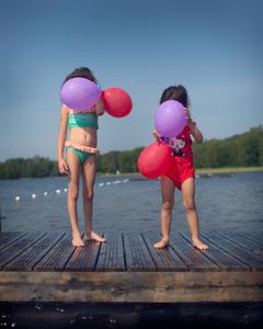 """Winner of the Catchlight Activist Awards Professional Category. """"The Secret Camps."""" Some children swim in a lake for the first time. They can play and laugh, without being scared."""