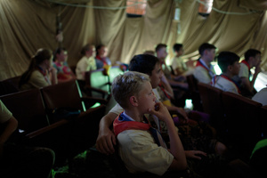 Students escape the heat and watch war films at the Historical-War Camp, in Borodino, Russia. 26 July 2016.
