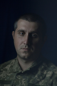 Andrij, 32, director of the company's credit,  picture was taken after he spent 12 months in the war zone, July 2015, Ukraine.