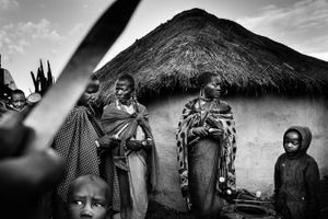 Women of the village peeling potatoes for the ritual dinner. © Meeri Koutaniemi