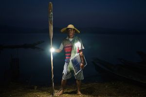 Ko Win Zaw Oo, 38, fisherman and father of 2 by his boat in Lui Pan Sone Village. Kayah State.