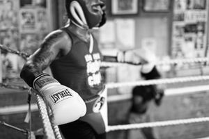 """Current (2012) light welterweight division champion Ashley """"Tresure"""" Theoprane (31 year old) is resting in the corner of the ring during the pause before his further practicing fight."""