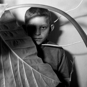 Study of boy and plant, 1999 © Roger Ballen. Courtesy of the artist and Camara Oscura Galeria de Arte, Madrid.