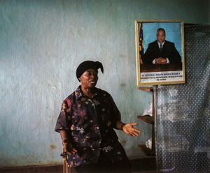 Seated in her office, Henriette Useni Kabake, Lulingu's government administrator, explains her position vis-a-vis the Raia Mutomboki. Herself a victim of the abuses of both the Interahamwe and the Armed Forces of the DRC, Henriette says she is happy with the security that the RM have brought to the area. © Diana Zeyneb Alhindawi