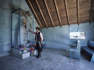 Gauchito Gil devotee at the shrine of the holy virgin in the temple of the popular saint in El Campito de la Carolina
