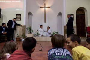 A young man gets baptized in the Romanian Baptist Church in Centocelle, a working class neighborhood in southern Rome.
