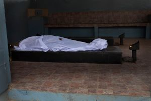 The body of an earthquake victim lies in a temple before a cremation ceremony in Kathmandu, Nepal