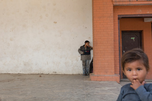 A group of street children from the Pashupatinath area of Kathmandu gather in the corner of an abandoned building to inhale glue.