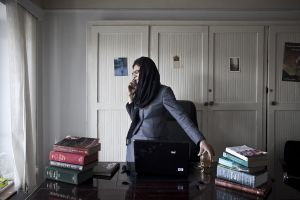 "Sherazad Akbar, 25, at her office. She is the CEO of Qara Consulting and is a member of ""1400"", a political group. 