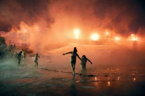 Ice swimming is one activity that people undertake to cope with the winter, even on days when the air feels -40° C. After diving into ice holes, swimmers warm up in small banyas (saunas) heated with the steam from the power plant. © Elena Chernyshova