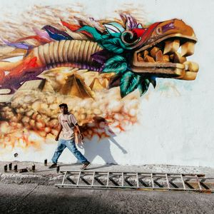 Quetzacoatl. A grafitti artist works on a Quetzalcoatl, the benign pre-hispanic God that gave corn and fire to men. © Hector Muñoz Huerta, Mexico, Shortlist, Arts & Culture, Open. Courtesy of 2015 Sony World Photography Awards.
