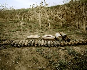 UNRECOGNIZED REPUBLIC OF NAGORNO-KARABAKH / Near Askeran / 8.09.2011. Lined-up dangerous remains of the Nagorno-Karabakh war (antitank mines and 'UXO' (Unexploded Ordnance) which have piled up during mine clearance in the country. These had been controlled by the mine-clearance organization 'Halo Trust', were then blown up under control and thereby rendered harmless.
