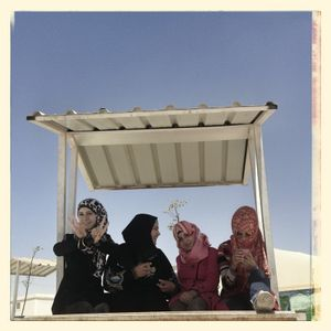 Nour*, Samar*, Jana* & Hiba* sat outside in the multiactivity centre area in Za'atari refugee camp.