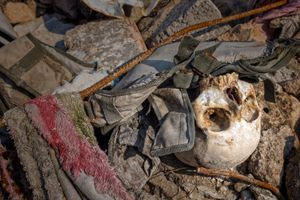 Thousands of corpses are still buried under the rubble and their stench lingers in the air.