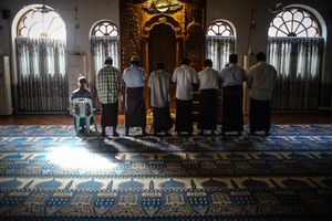 All religious minorities have their own places in Yangon.Sunni Muslims are in praying in the mosque.