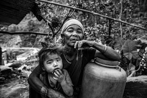 Maldhani Gurung a 70-year-old woman with her granddaughter in the village of Baluwa, Gorkha District, near the epicenter of the 2015 earthquake.