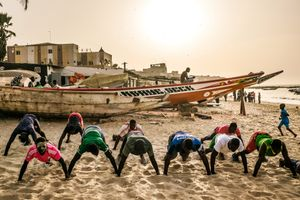 The new generation of wrestlers train on the beach of Ngor in Dakar. Ten thousands of young men want to make a career as a Wrestler in Senegal now, in hope to become rich and famous soon.