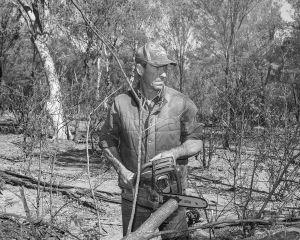Matt cutting trees, Wyoming Station, Charleville, QLD Australia, 2015.
