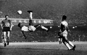 Brazilian soccer player Pelé, doing a perfect bicycle kick during a game when Brazil beat Belgium 5-0  in Maracanã Stadium in Rio de Janeiro. © Alberto Ferreira. Represented by Lume Gallery in São Paulo, Brazil.