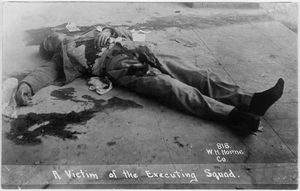 © Walter H. Horne, A Victim of the Executing Squad, 1913. Photograph postcard. Research Library, The Getty Research Institute, Los Angeles.