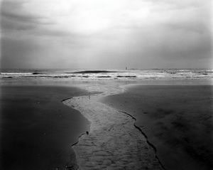 "Water goes into the Pacific Ocean near Iwaki city, some 40 km south of the Fukushima Daiichi nuclear plant. One of the biggest problems today is that contaminated water is still leaking into the ocean from the ruins of the nuclear plant. From the series ""Fragments/Fukushima"" © Kosuke Okahara"