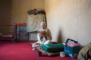 © Iva Zimova. An elderly man reads the Quran.