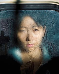 """From the series """"Tokyo Compression,"""" a series of candid portraits of Japanese commuters enduring the inhuman daily crush of bodies in Tokyo's subway cars."""