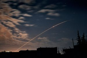 A missile fired by the Syrian government forces flies in an arc over Aleppo on the evening of April 18, 2013. Syrian government shelling is a constant in the country's brutal civil war. © Nish Nalbandian