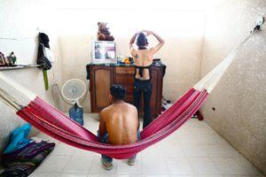 Deborah is preparing herself to work while her boyfriend will stay home. © Meeri Koutaniemi