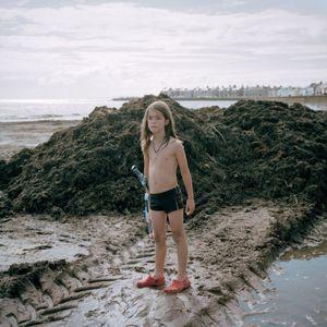 Boy Playing War on the Beach