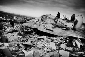 © Jan Grarup (Denmark) A man sitting on top of his house in the outskirts of Gaza city, January 2009. Beneath lies his entire family of seven people killed by bombs dropped by Israeli fighter planes. Honorable Mention, LensCulture Exposure Awards 2009