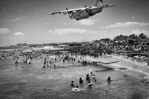 """Winner of the Catchlight Activist Awards Emerging Category. """"Koodankulam: A Nuclear Plant in My Backyard."""" An Indian Coast Guard plane flies too low over the protesting villagers, who have ventured into the sea as a part of their Jal Satyagraha."""