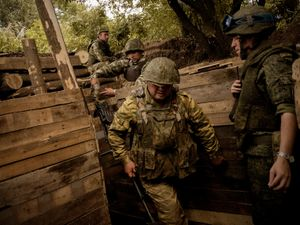 Soldiers in a trench near Donetsk.