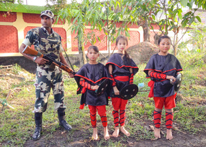 Dancers and Army soldier at a cultural event, Imphal, Manipur.