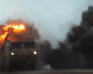 Early morning IED attack (Distantly filmed by the enemy).