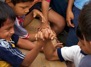 Arm Wrestling in the Amazon - © Adel Korkor