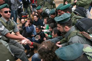 Israeli border policemen evict left-wing activists during the evacuation of 20 families from Kfar Shalem neighbourhood in Tel Aviv, Israel, 2008.