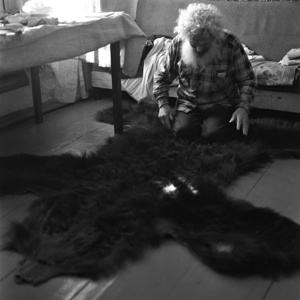 Gregoriy Denisenko, 82.  In Vasyugan, Gregoriy shot down more than forty bears. There is a bearskin on the floor, he killed this bear at the age of 76. The fight was very hard. The bear, wounded with a gun, but still fighting for his life, crippled Gregoriy's right arm severely. Eventually Gregoriy had to finish off the bear with a knife in close combat.Noviy Vasyugan. Tomsk region. Russia. 2009.
