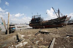 Boats at Dala township riverbed.