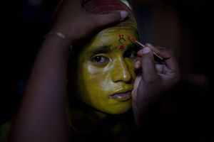 Charak Puja, Bhimshi Bhonubhir, Srimangal, Bangladesh  A boys face is painted as he prepares to enact the part of Parvati, the wife of Shiva, at the festival of Charak Puja in Bhimshi Bhonubhir, Sylhet. © Claudio Cambon