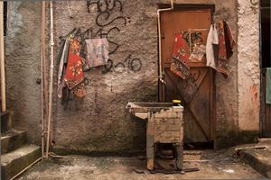 Rocinha is located on a steep hillside, not more than a kilometer away from the famous beaches of Rio. Rochina has less and less infrastructure as one climbs higher. This is a laundry tub in one of the highest streets of Rochina. Laundry tubs and still water are the main cause of dengue fever, a widespread illness in the favelas. © Manu Valcarce