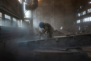 Yuriy while sandblasting the radioactive scrap metal, Chernobyl exclusion zone