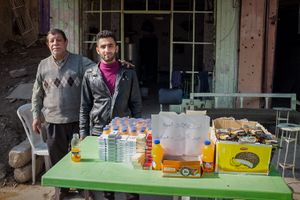 A father and son have set up shop again on an otherwise deserted street.